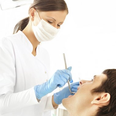 At dentist's office - young woman dentist working