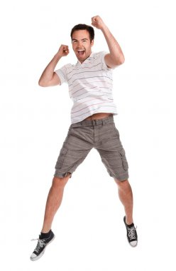 Young happy man jumping on a white
