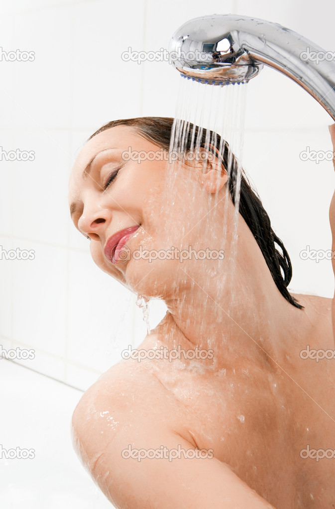 Females taking a shower with clothes on