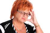 Zralá žena s bolestí hlavy