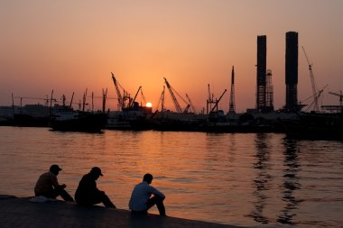 Workers rest in the port Sharjah.