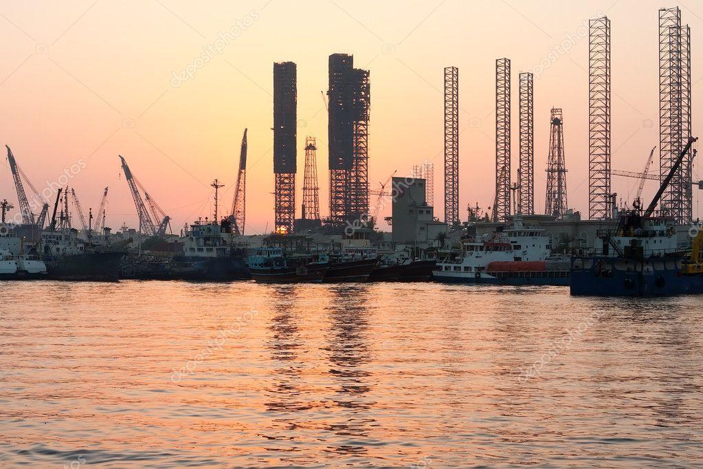 Oil rigs at sunset, Sharjah, Uae