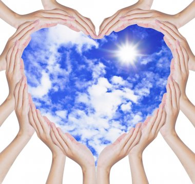 Hands make heart shape on blue sky