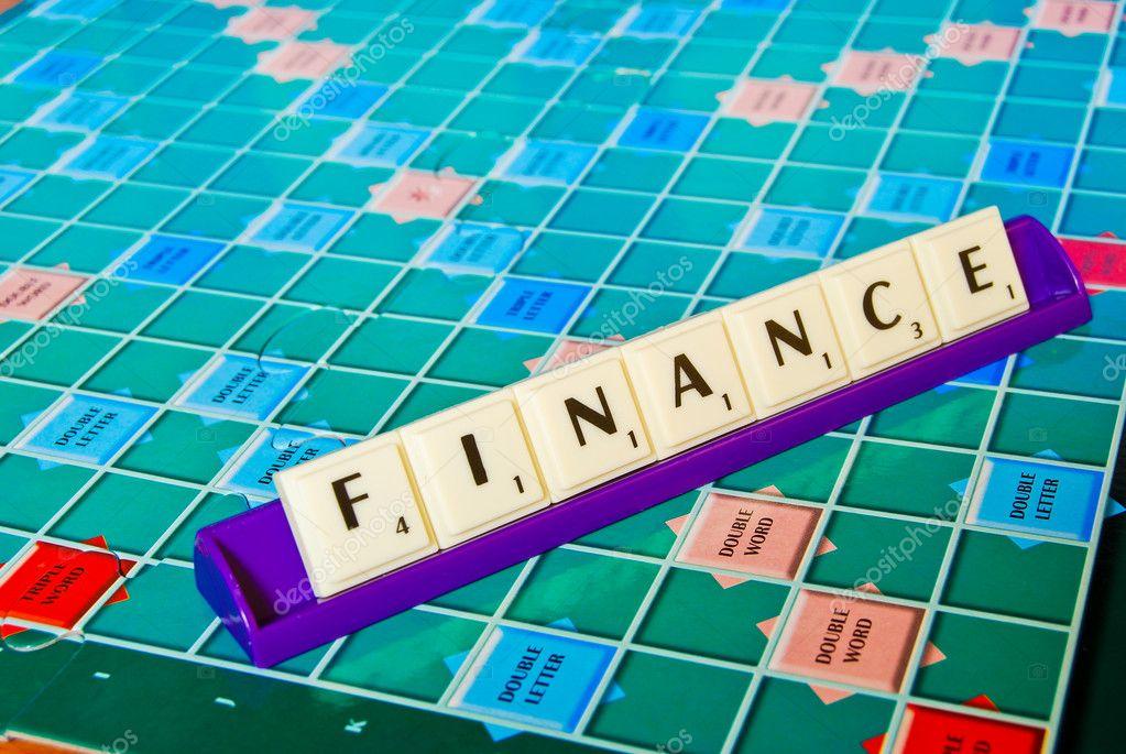 Letra De Finanzas En La Ficha Del Juego De Mesa Foto De Stock