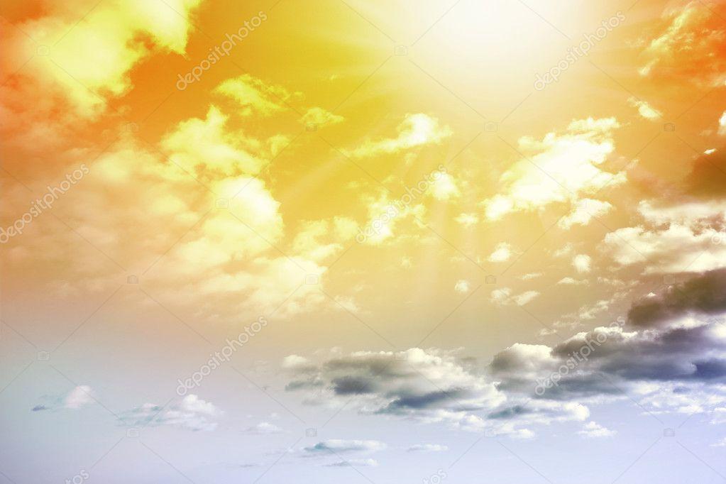 Sun shining brightly in summer sky