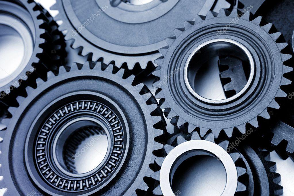 Closeup of several steel cog wheels