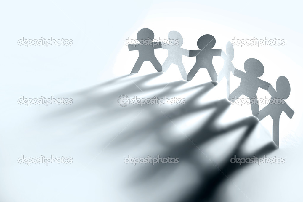 Group of holding hands casting shadows