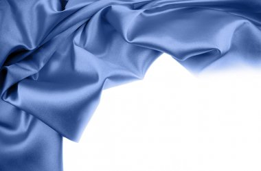 Blue silk material on white background. Copy space