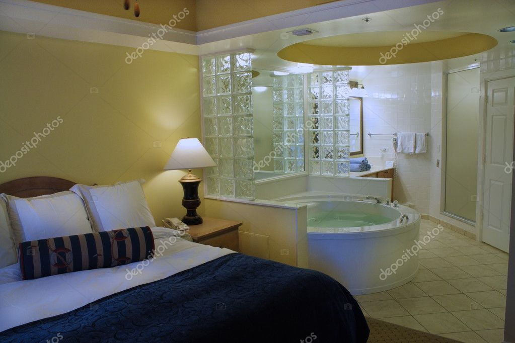 Master bedroom with jacuzzi tub stock photo for Tub in master bedroom