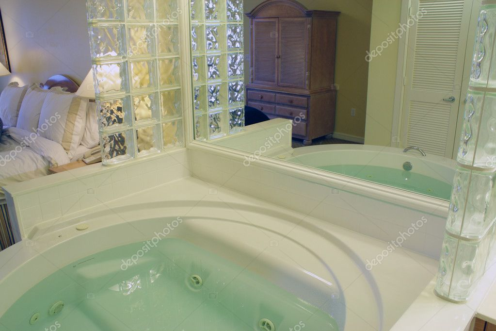 A Large Jacuzzi Tub With Mirror And Glass Bricks U2014 Photo By Csproductions