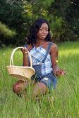 Fényképek Beautiful Woman in Grassy Field with a Basket (1)