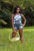 Fényképek Beautiful Woman in Grassy Field with a Basket (2)