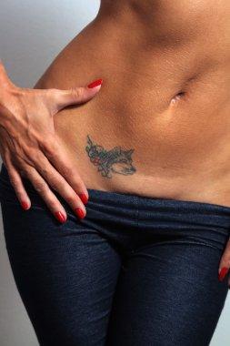 Sexy Female Abdomen with Tattoo (1)