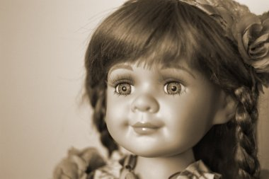 Antique porcelain doll on a light background