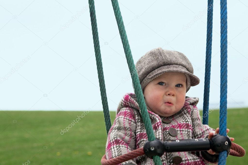Sad Baby Girl On A Swing  Stock Photo -1405