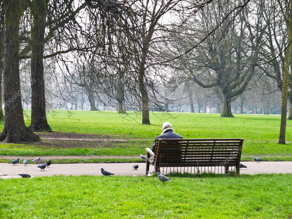 Man in the garden with the pigeons
