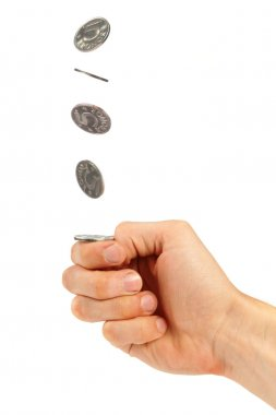 Hand flipping a coin