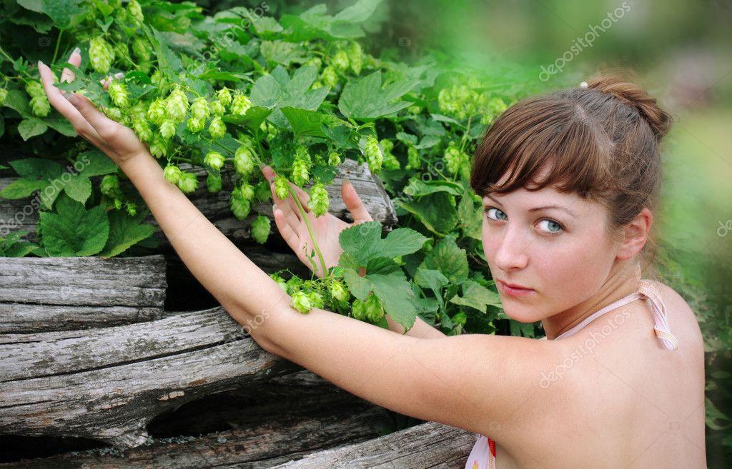 Girl holds green hop