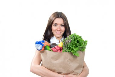 Woman holding a shopping bag full of vegetarian groceries