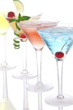 Martini alcohol cocktails in row blue hawaiia