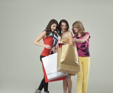 Young women looking happy shopping bags