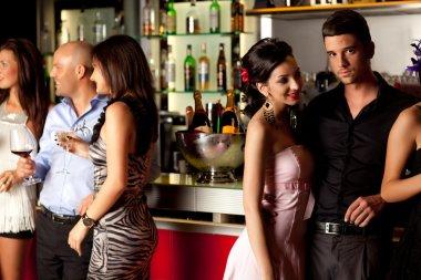 Young at bar counter