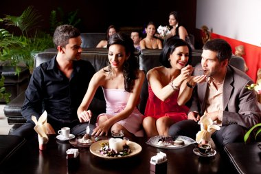 Young couples eating deserts