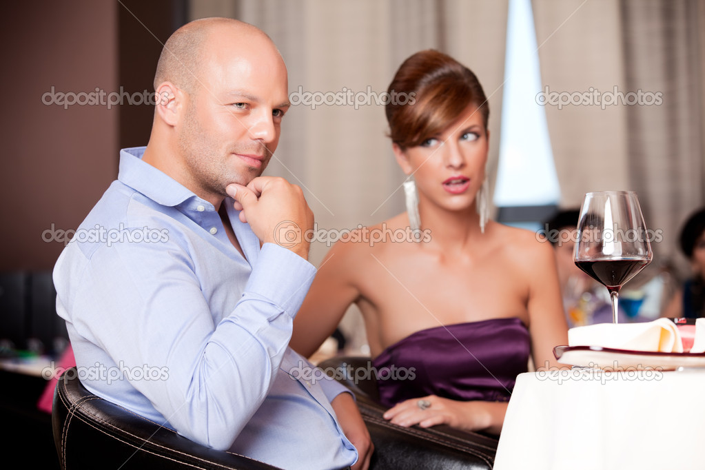 Couple having an argument at restaurant table