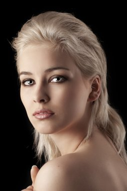 Beauty portrait of a blonde short hair girl