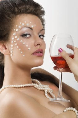 Girl with glass red wine