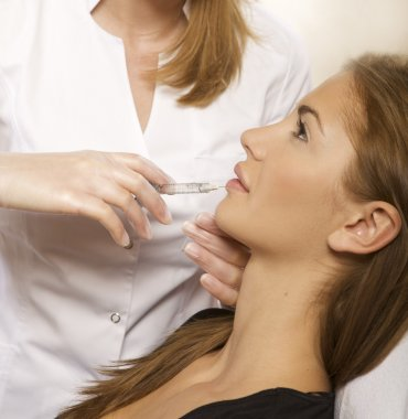 Young beautiful woman having an injection