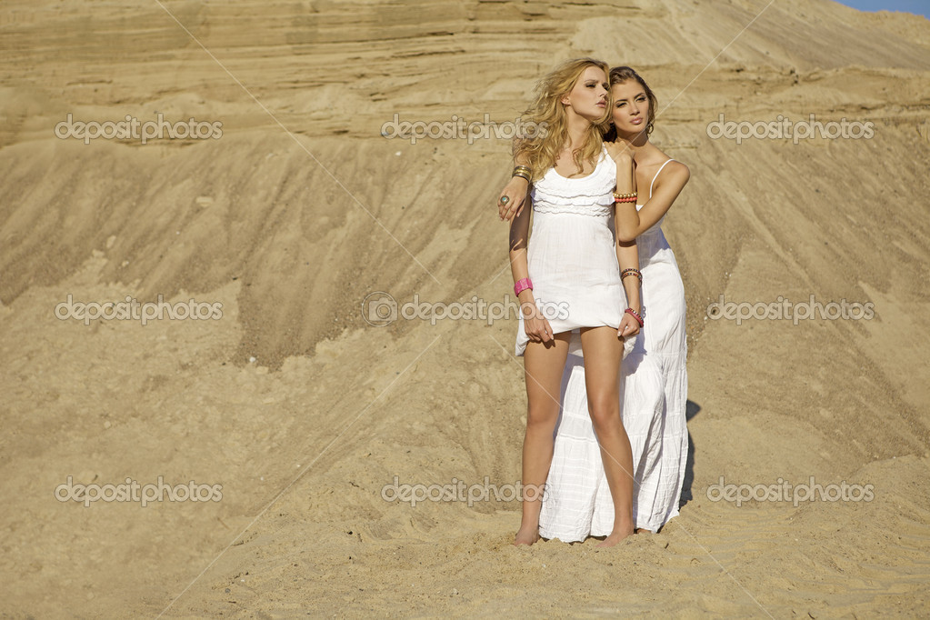 Two girl in desert