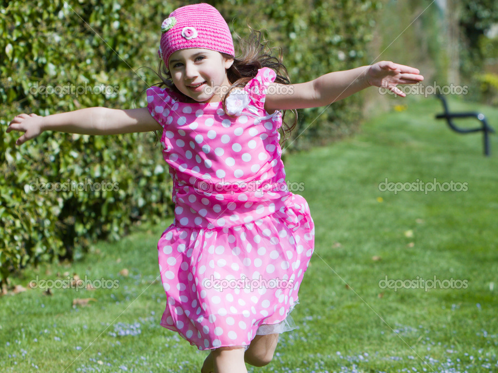 Young girl running and flying