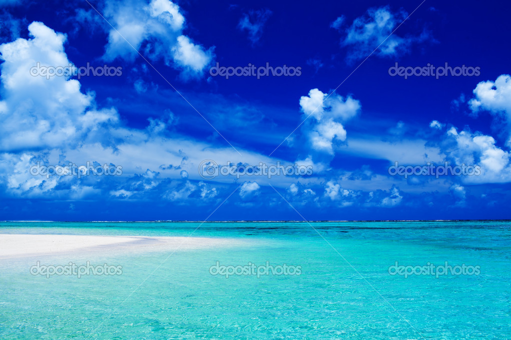 depositphotos_6627300-stock-photo-beach-with-blue-sky-and
