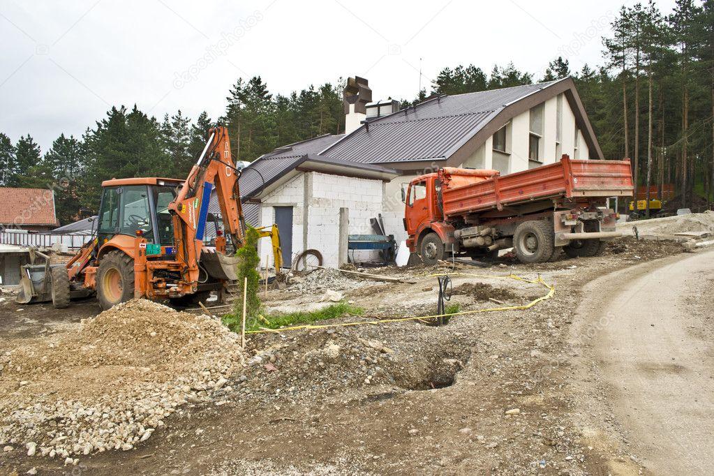 Excavator on site working,road repair,building house