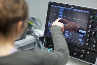 Female scientist doing research in a quantum optics lab (color t