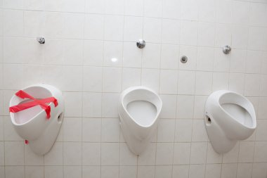 Out of order concept - man restroom with three urinals/pissoirs