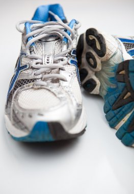 Pair of running shoes on a white background (shallow DOF; color
