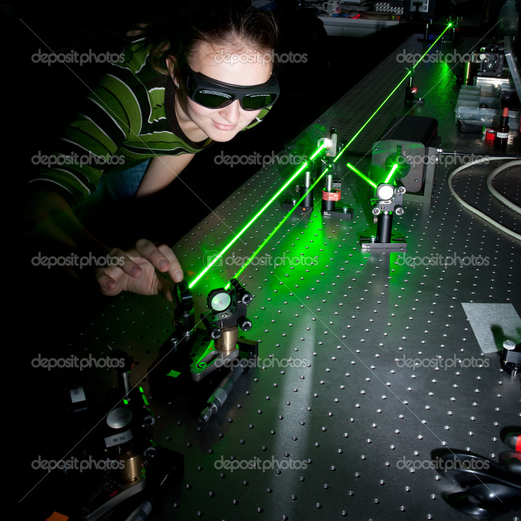 Female scientist doing research in a quantum optics lab