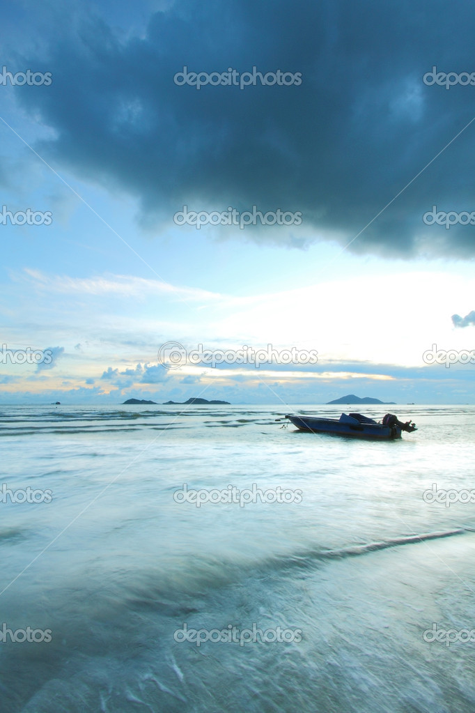 A boat in the sea with thunderstorm coming