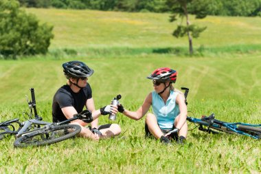 Sport mountain biking couple relax sunny meadows