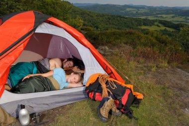 Camping young couple sleeping tent climbing gear