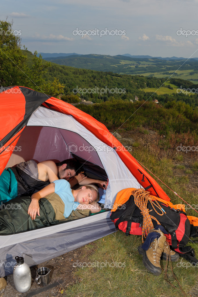 C&ing young couple backpackers sleeping in tent with climbing gear u2014 Photo by CandyBoxImages & Camping young couple sleeping tent climbing gear u2014 Stock Photo ...