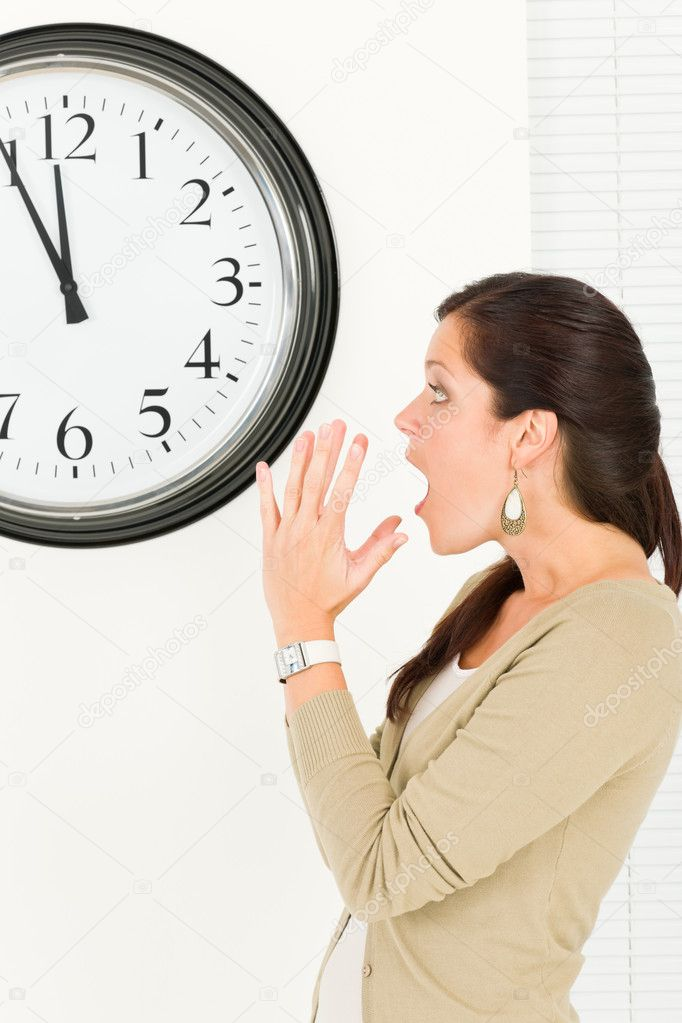 surprised punctual businesswoman looking at clock stock photo