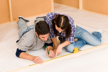 Home improvement young couple measure with rule