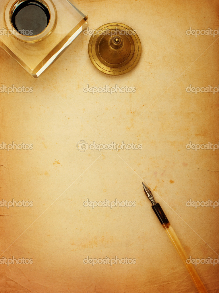 Pen and inkwell and old paper