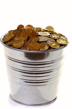 Zinc bucket of gold coins on a white background.
