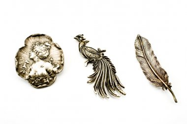 Three antique silver brooches