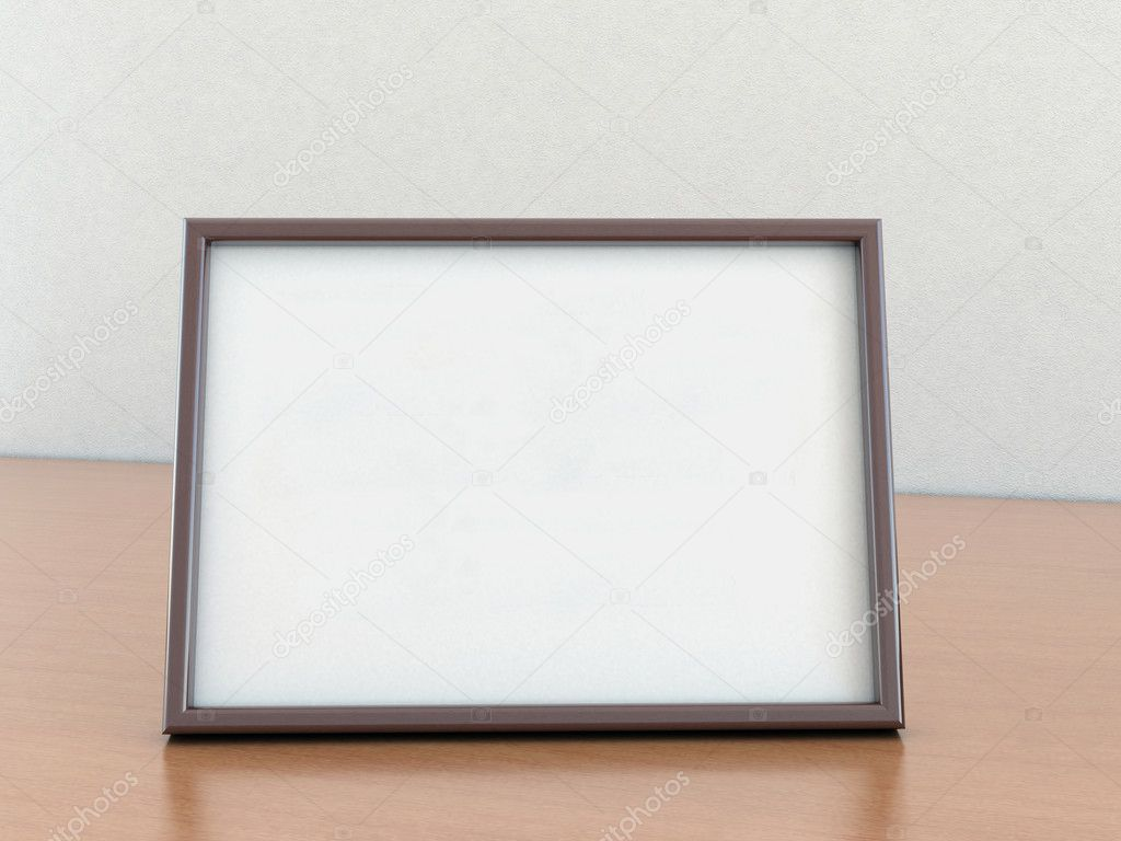An empty photo frame stands on a wooden table — Stock Photo ...