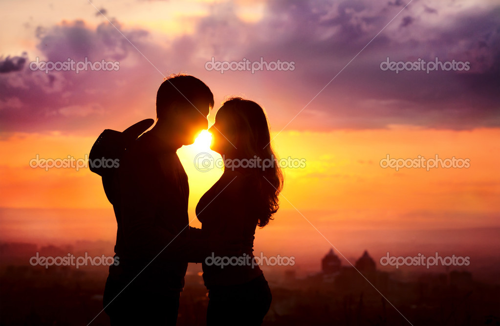 Couple silhouette at sunset
